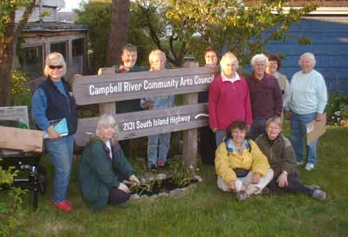 [Garden Club members volunteer to plant Sybil Andrews cottage garden]